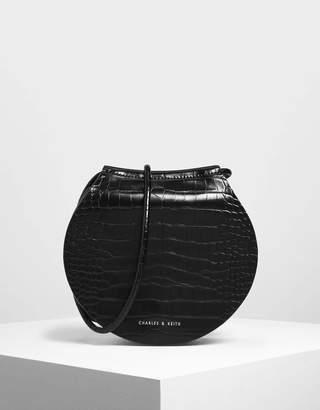 Charles & Keith Semi Circle Croc-Effect Crossbody Bag