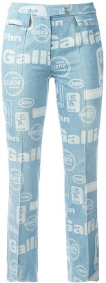 John Galliano Pre-Owned Galliano Team print flared jeans