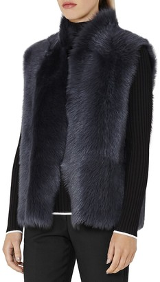 REISS Tessa Reversible Shearling Vest $1,120 thestylecure.com
