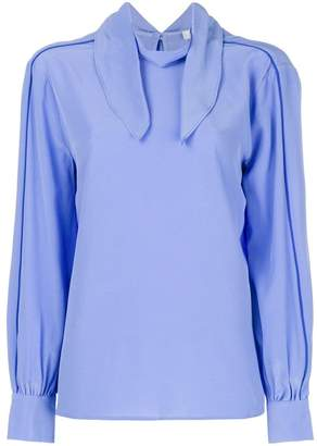 Closed long-sleeve fitted blouse