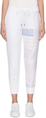 93e05ed858e4 Thom Browne Stripe patchwork leg sweatpants