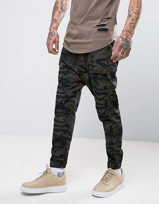 ASOS Drop Crotch Joggers In Camo Twill Overdye $56 thestylecure.com