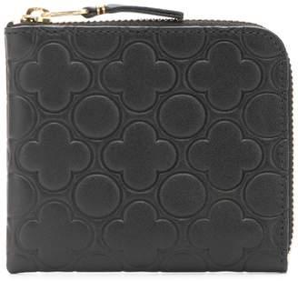 Comme des Garcons embossed leather zip wallet