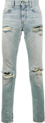 Saint Laurent distressed skinny jeans $1,257 thestylecure.com