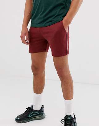 Asos Design DESIGN jersey skinny shorts in shorter length with piping in burgundy