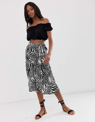 a2f52affde B.young zebra print bias cut midi skirt