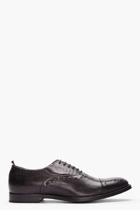 Alexander McQueen black leather reverse brogues