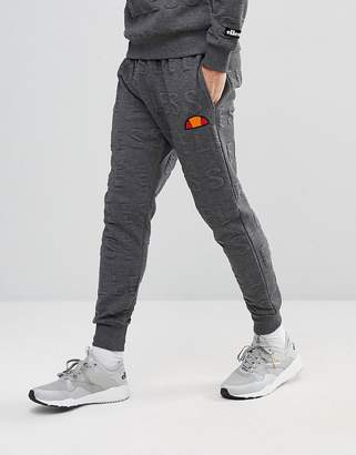 Ellesse Joggers With All Over Embossed Logo In Gray