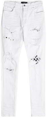 Amiri Art Patch Distressed Skinny Jeans