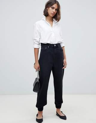 Asos DESIGN denim track pant in washed black