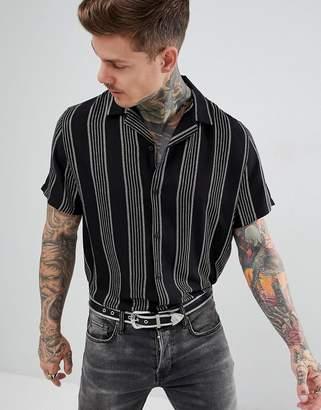 Asos DESIGN oversized stripe shirt in black & gold with revere collar