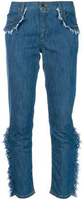 Moschino frayed ruffle trim jeans