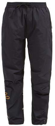 MHI Xian Crane Embroidered Twill Track Pants - Womens - Navy