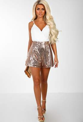 fa3226afb798 Pink Boutique Easy Does It White And Rose Gold Sequin Wrap Front Playsuit