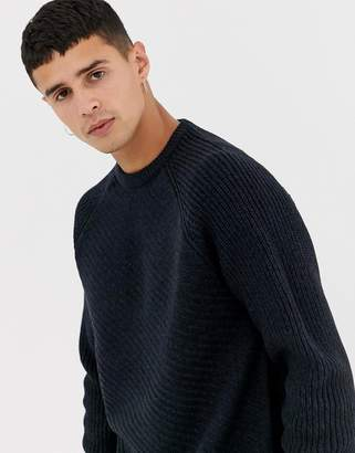 Kiomi jumper in navy with diagonal cable knit