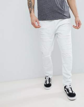 Asos DESIGN Drop Crotch Jeans In Bleach Wash Blue With Extreme Rips