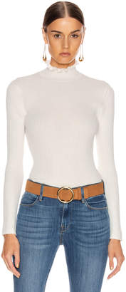 Frame Ruffle Turtleneck Sweater in Off White | FWRD