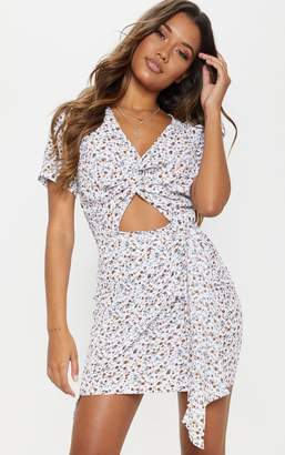 PrettyLittleThing Cream Floral Print Twist Front Skater Dress 2e5481782
