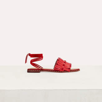 Maje Flat sandals with ties in leather