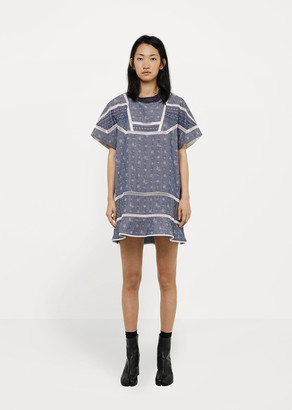 Sacai Peplum Dress with Eyelet Trim $862 thestylecure.com