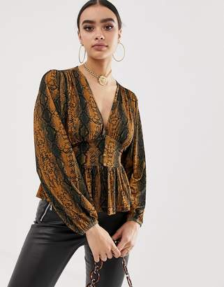 Asos Design DESIGN long sleeve top with balloon sleeve and corset waist in snake print