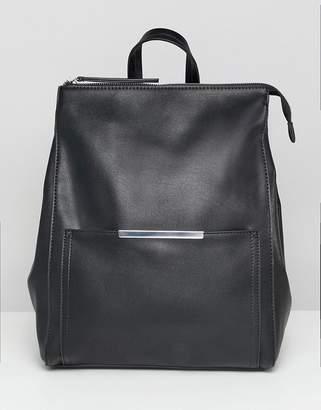 Asos DESIGN minimal backpack with bar detail