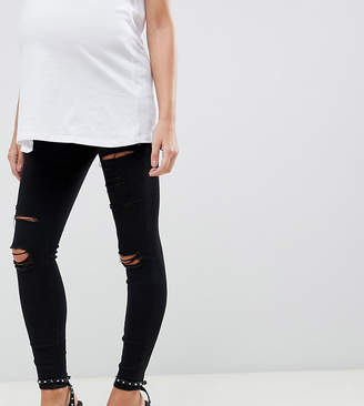 Asos DESIGN Maternity Ridley high waist skinny jeans in black with shredded rips and under the bump waistband
