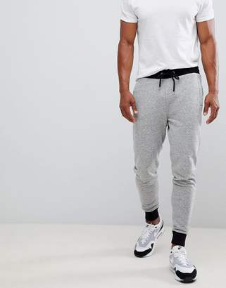 Asos DESIGN skinny joggers in gray nep with contrast cuffs and waistband