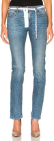 Off-White for FWRD Skinny Jeans in Blue.