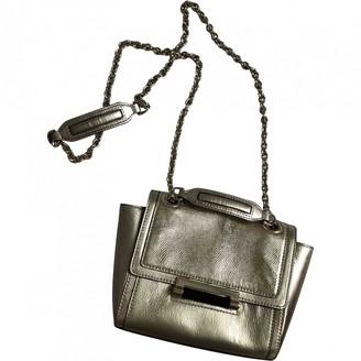 Diane von Furstenberg Gold Leather Handbags