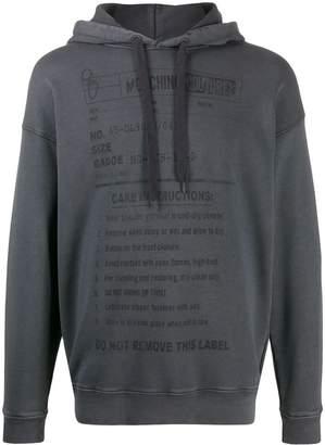 Moschino care instruction hoodie