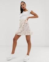 NA-KD Na Kd floral print mini frill skirt in blush pink