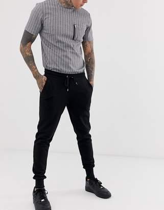 Asos Design DESIGN skinny sweatpants in black with deep rib cuff