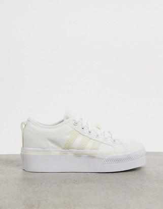 adidas Nizza Platform trainers with cord detail in white