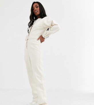 Asos Tall ASOS DESIGN Tall denim belted jumpsuit in ivory with contrast top stitch