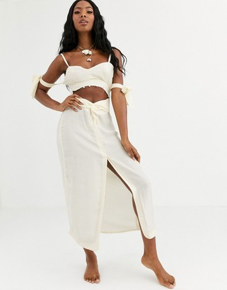 Asos DESIGN beach maxi dress in natural fabrication with cut out waist & tie sleeves with shell trim
