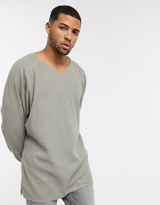 ASOS DESIGN oversized waffle long sleeve t-shirt with notch neck in washed khaki