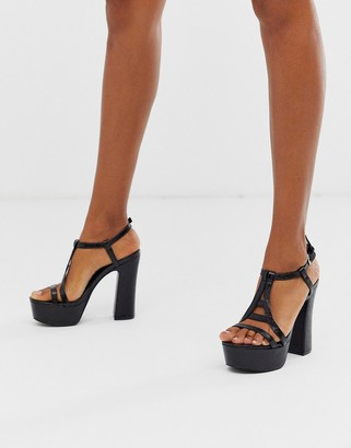 Co Wren extreme platform heeled sandals in snake