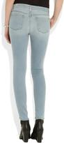 J Brand 811 Rapture distressed mid-rise skinny jeans