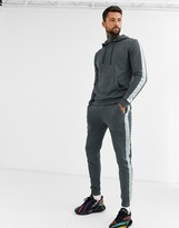 Asos Design DESIGN tracksuit hoodie/skinny sweatpants with satin side stripe in washed black