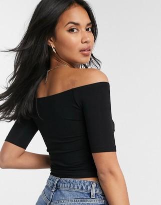 ASOS DESIGN sexy off shoulder wrap front top in black