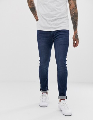 Levi's 519 super skinny fit low rise jeans in sage overt advanced mid wash-Blue