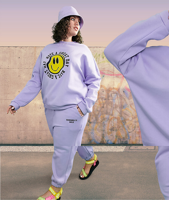 ASOS DESIGN Curve oversized tracksuit with happy face graphic in lilac