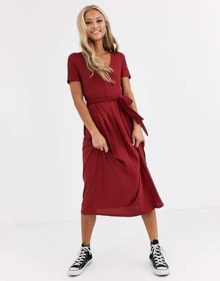 Asos Design DESIGN textured v neck midi dress with pleated skirt