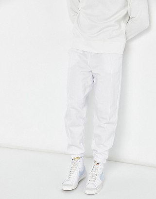 ASOS DESIGN co-ord oversized joggers in white with pin tucks