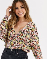 Asos Design DESIGN wrap top in slinky fabric with batwing sleeve in ditsy