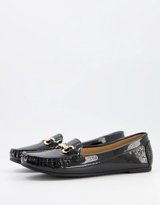 Truffle Collection flat loafers with metal trim in black patent