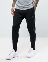 Nike Tech Knit Joggers In Tapered Fit In Black 832180-010