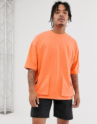 ASOS DESIGN oversized t-shirt with half sleeve in heavyweight jersey with utility pockets