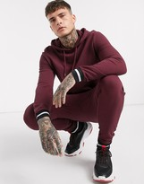 Asos Design DESIGN tracksuit with hoodie & striped rib in burgundy